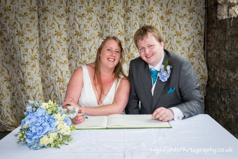 Signing the register at Banwell Castle Wedding Somerset