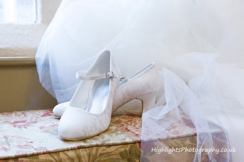 Brides Shoes at a Wedding at Tortworth Court